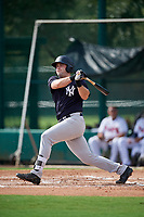 GCL Yankees West third baseman Mitchell Robinson (34) follows through on a swing during the first game of a doubleheader against the GCL Braves on July 30, 2018 at Champion Stadium in Kissimmee, Florida.  GCL Yankees West defeated GCL Braves 7-5.  (Mike Janes/Four Seam Images)