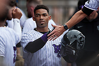 Yoelqui Cespedes (15) of the Winston-Salem Dash is congratulated by teammates after scoring a run during the game against the Greensboro Grasshoppers at Truist Stadium on June 19, 2021 in Winston-Salem, North Carolina. (Brian Westerholt/Four Seam Images)
