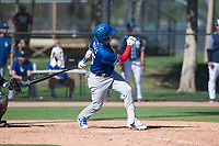 Los Angeles Dodgers outfielder Andy Pages (65) follows through on his swing during an Instructional League game against the San Diego Padres at Camelback Ranch on September 25, 2018 in Glendale, Arizona. (Zachary Lucy/Four Seam Images)