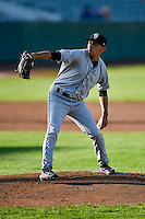 Grand Junction Rockies starting pitcher Luis Guzman (19) delivers a pitch to the plate against the Ogden Raptors in Pioneer League action at Lindquist Field on August 24, 2016 in Ogden, Utah. The Raptors defeated the Rockies 11-10. (Stephen Smith/Four Seam Images)