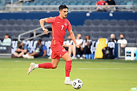 KANSAS CITY, KS - JULY 15: Stephen Eustaquio #7 of Canada with the ball during a game between Canada and Haiti at Children's Mercy Park on July 15, 2021 in Kansas City, Kansas.