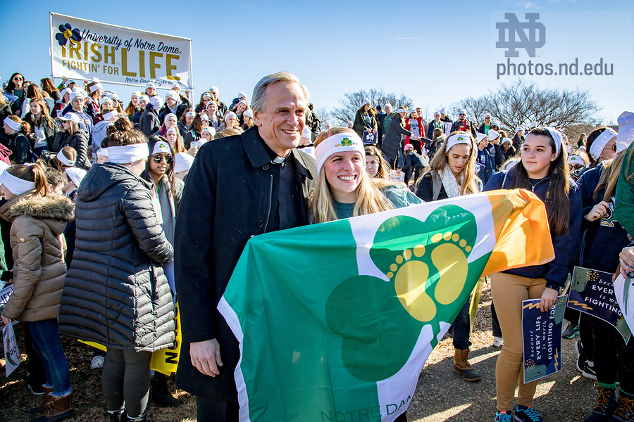January 19, 2018; Rev. John I. Jenkins, C.S.C. takes photos with students at the March for Life in Washington D.C.. (Photo by Matt Cashore/University of Notre Dame)