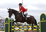 Hawley Bennett-Awad and Gin & Juice of Canada compete in the final stadium jumping round of the FEI  World Eventing Championship at the Alltech World Equestrian Games in Lexington, Kentucky.