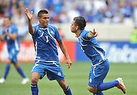 Rodolfo Zelaya Garcia (11) of El Salvador celebrates with his team mate Ceren Delgado his score.  Trinidad & Tobago tied El Salvador 1-1 in the first round of the Concacaf Gold Cup, at Red Bull Arena, Monday July 8 , 2013.