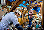 PANAMA CITY, FL-DECEMBER, 15:  Teri and Bryan Leverett work in the kitchen of their home in Southport, 20 miles inland from Panama City Beach, Fl. where they are living in a hotel December 15, 2018 more than two months after Hurricane Michael made landfall.  (Photo by Mark Wallheiser/ For the Washington Post)