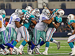 Miami Dolphins linebacker Cameron Collins (45), Miami Dolphins defensive tackle Kheeston Randall (97) and Dallas Cowboys tackle Ronald Leary (65) in action during the pre- season game between the Miami Dolphins and the Dallas Cowboys at the Cowboys Stadium in Arlington, Texas. Dallas defeats  Miami 30 to 13..