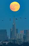 August full moon over San Francisco's skyline