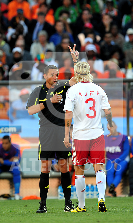 3 Simon KJAER getting a yellow card during the 2010 World Cup Soccer match between Denmark and Nederland played at Soccer City Stadium in Johannesburg South Africa on 14 June 2010.