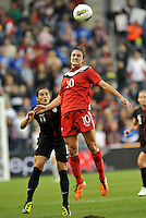 Canada forward Christina Julien (10) heads the ball watched by Ali Krieger (11).