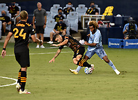 KANSAS CITY, KS - AUGUST 25: Matias Vera #22 of Houston Dynamo battles for the ball with Gianluca Busio #27 of Sporting Kansas City during a game between Houston Dynamo and Sporting Kansas City at Children's Mercy Park on August 25, 2020 in Kansas City, Kansas.