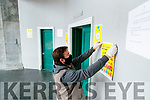 Tralee Courthouse caretaker Thomas O' Mahoney removing signs after the court was closed suddenly on Wednesday.