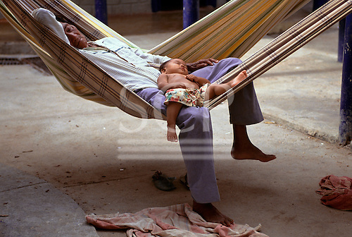 Boa Vista, Roraima State, Brazil. Yanomami man and a child recovering from malaria.