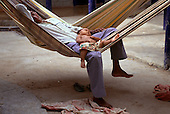 Boa Vista, Roraima State, Brazil. Yanomami man and a child recovering from malaria.
