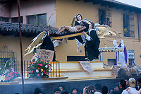 Antigua, Guatemala.  Incense Rises around an Anda Showing Jesus Crucified, Surrounded by Angels.  Semana Santa Procession, Good Friday.