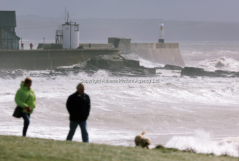 """WEATHER PICTURE WALES<br />Pictured: Dog walkers on the coast in Porthcawl, Wales, UK. Monday 11 September 2017<br />Re: A yellow """"be aware"""" weather warning of very strong winds has been issued across south and west Wales The Met Office HAS warned.<br />Gusts could reach 50 mph inland and 60 mph along the coast."""