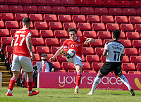24th April 2021, Oakwell Stadium, Barnsley, Yorkshire, England; English Football League Championship Football, Barnsley FC versus Rotherham United; Callum Styles of Barnsley passes the ball under pressure from Chiedozie Ogbene of Rotherham with captain Alex Mowatt of Barnsley providing cover