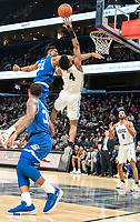 WASHINGTON, DC - FEBRUARY 05: Ike Ibiagu #21 of Seton Hall and Jagan Mosely #4 of Georgetown clash at the basket during a game between Seton Hall and Georgetown at Capital One Arena on February 05, 2020 in Washington, DC.