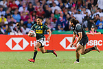 Selvyn Davids of South Africa (L) runs with the ball during the HSBC Hong Kong Sevens 2018 Bronze Medal Final match between South Africa and New Zealand on 08 April 2018 in Hong Kong, Hong Kong. Photo by Marcio Rodrigo Machado / Power Sport Images