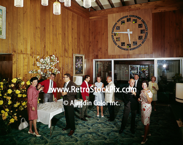 People enjoying a formal party in the motel lobby.