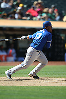 OAKLAND, CA - SEPTEMBER 5: Salvador Perez #13 of the Kansas City Royals bats against the Oakland Athletics during the game at O.co Coliseum on September 5, 2011 in Oakland, California. Photo by Brad Mangin