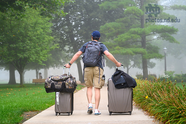 August 21, 2019; An early move-in student arrives on campus on a misty morning. (Photo by Matt Cashore/University of Notre Dame)