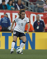 USWNT midfielder Heather O'Reilly (9) controls the ball. In an international friendly, the U.S. Women's National Team (USWNT) (white/blue) defeated Korea Republic (South Korea) (red/blue), 4-1, at Gillette Stadium on June 15, 2013.