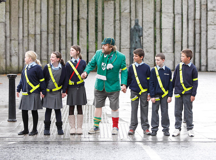 ".Niamh O'Reilly (left) with Claire Walsh, Aideen Caulfield, Ryan McDonnell, David Gavin and Conor Moran (right), all pupils from Derrywash National School, Castlebar, Co. Mayo pictured here with ""Bottler"", Brendan Grace in St. Stephen's Green, Dublin at the launch of the Safe Cross Code by the  Road Safety Authority. Pic Robbie Reynolds"