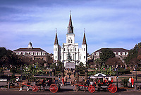 Jackson Square overview with quaint horse-drawn carriages and ornate background architecture. French Quarter, New Orleans, Louisiana.
