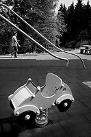 Switzerland. Canton Luzern. Rothenburg. Neuenkirch West. Luzerner Raststätte West A2 is a rest area on the A2 highway. The A2 (the Gotthard Motorway) is a motorway which forms Switzerland's main north–south axis. Children playground. Swing car. A father holds in his hands frozen ice-cream cones which he brings to his family. 16.05.2020 © 2020 Didier Ruef