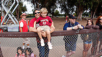 STANFORD CA - August 21, 2011:  Fans watch The Stanford Cardinal Football Open Practice on Sunday, August 21, 2011 at  Steuber Rugby Stadium. <br /> <br /> After the practice at the Stanford Football Open house in Stanford Stadium youngsters got to practice at skills stations run by Stanford Football coaches. Fans of all ages were able to watch the 2011 squad practice, get autographs from their favorite players, and have their pictures taken with the 2011 Orange Bowl Trophy.