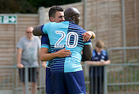 Adebayo Akinfenwa of Wycombe Wanderers (20) congratulates Luke O'Nien of Wycombe Wanderers  on his second goal of the game to make it 1-3 during the Friendly match between Maidenhead United and Wycombe Wanderers at York Road, Maidenhead, England on 30 July 2016. Photo by Alan  Stanford PRiME Media Images.