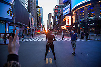 NEW YORK, NEW YORK - JUNE 1: Protesters stand on the street as they watch the phenomenon known as Manhattanhenge in Times Square on May 1, 2020 in New York. The protests spread across the country in at least 30 cities across the United States, over the death of unarmed black man George Floyd at the hands of a police officer, this is the latest death in a series of police deaths of black Americans. Today is the first night of a curfew in New York City (Photo by Pablo Monsalve / VIEWpress via Getty Images)