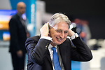 © Joel Goodman - 07973 332324 . 02/10/2017. Manchester, UK. Chancellor PHILIP HAMMOND being interviewed by Robert Peston , at the start of the second day of the Conservative Party Conference at the Manchester Central Convention Centre . Photo credit : Joel Goodman