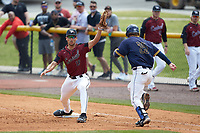 North Carolina Central Eagles first baseman Justin Bowers (19) stretches for a throw as Ryne Stanley (25) of the North Carolina A&T Aggies hustles down the line at Durham Athletic Park on April 10, 2021 in Durham, North Carolina. (Brian Westerholt/Four Seam Images)