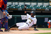 Bradenton Marauders Lolo Sanchez (18) slides home safely during a Florida State League game against the St. Lucie Mets on July 28, 2019 at LECOM Park in Bradenton, Florida.  Bradenton defeated St. Lucie 7-3.  (Mike Janes/Four Seam Images)