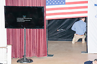 People get the stage ready before Texas senator and Republican presidential candidate Ted Cruz speaks during a town hall event at Peterborough Town House in Peterborough, New Hampshire, on Sun., Feb. 7, 2016.