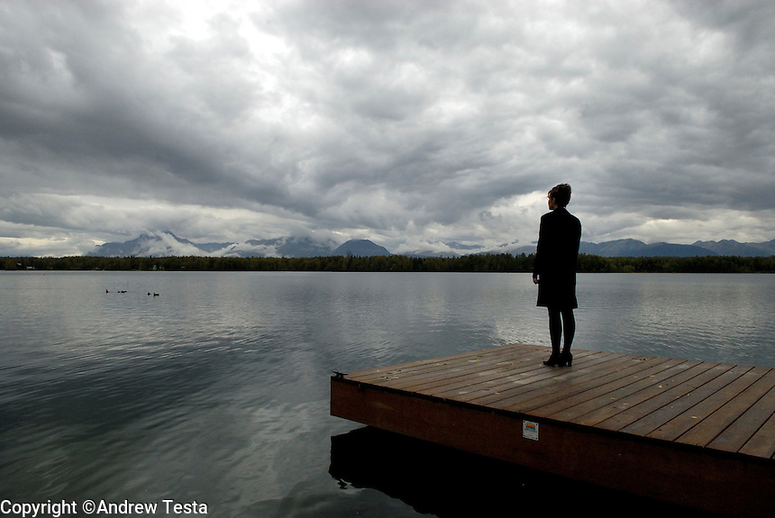 USA. Alaska.  13th September 2007.Governor Palin stands on her jetty looking towards the mountains at her private home in Wasilla..©Andrew Testa/Panos