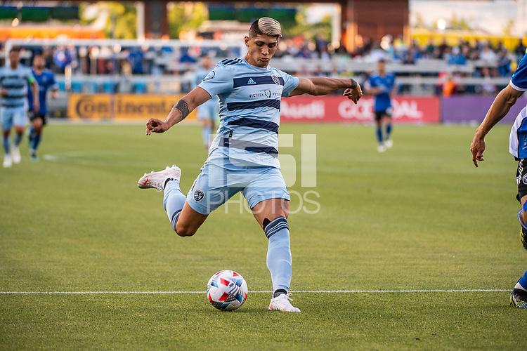 SAN JOSE, CA - MAY 22: Alan Pulido #9 of Sporting Kansas City passes the ball during a game between San Jose Earthquakes and Sporting Kansas City at PayPal Park on May 22, 2021 in San Jose, California.