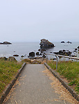 Stairway and sidewalk to beach, Crescent City, California.  A rocky, Pacific Ocean coastline with stunning views, sea stacks, sandy coves, scuba diving, kayaking, and deep sea fishing.