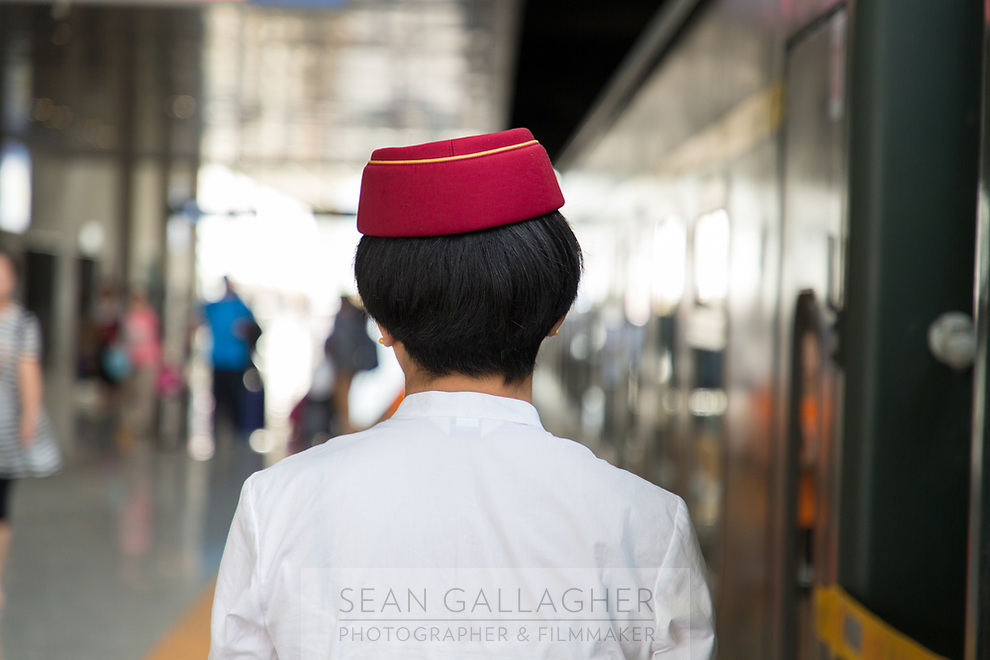 A train worker in Xining railway station, one of the main stops on the train journey that runs into Tibet and onto Lhasa.
