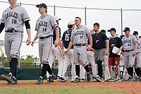 Edgewood Eagles shake hands with Bethel Wildcats after the second game of a double header on March 15, 2019 at Terry Park in Fort Myers, Florida.  Bethel defeated Edgewood 3-2.  Shown include Ryan Gale (14), Dane Lamont (17), Branden Cohn (23).  (Mike Janes/Four Seam Images)