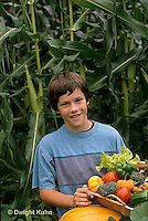 HS18-087z  Boy harvesting vegetables -  tomato, cucumber, carrot, squash, broccoli, lettuce, pumpkin