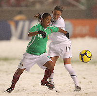 USA's Meghan Schnur (R) fights for the ball with Mexico's Maribel Dominguez (L) at Rio Tinto Stadium March 31, 2010 in Salt Lake City, Utah. The USA women won the match over Mexico 1-0.