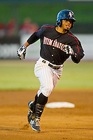 Jacob May (20) of the Kannapolis Intimidators rounds second base on his way to an inside-the-park home run against the Lakewood BlueClaws at CMC-Northeast Stadium on August 13, 2013 in Kannapolis, North Carolina.  The Intimidators defeated the BlueClaws 12-8.  (Brian Westerholt/Four Seam Images)