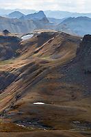 Snow and high-altitude vegetation from the southeast ridge of Wetterhorn Peak.