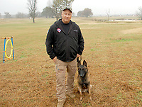Marc Hayot/Herald Leader Rob Shewmake posing with Pike at Joint Forces K9 Group.