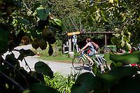 A cyclist leaves the restaurant after lunch, Zehendermätteli, Bern, Switzerland, 26 August 2011