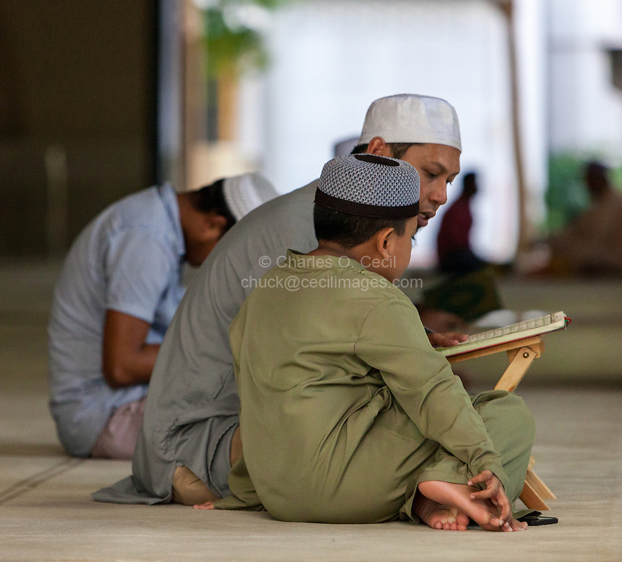 Father and Son after Friday Prayers at Masjid Al-Islah, Al-Islah Mosque, Singapore.