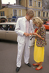 Tallinn Estonia 1980s. A Baltic State country part of the USSR. A modern young couple smartly dressed check their lottery tickets to see if they have been lucky 1989 .