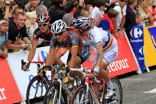 Lance Armstrong (USA) Team Radioshack crosses the line in the company of Alexandr Pliuschin (MOL) Team Katusha and Luis-Leon Sanchez (ESP) Caisse d'Epargne at the end of the final Stage 20 of the 2010 Tour de France running 102.5km from Longjumeau to Paris Champs-Elysees, France. 25th July 2010.<br /> (Photo by Eoin Clarke/NEWSFILE).<br /> All photos usage must carry mandatory copyright credit (© NEWSFILE | Eoin Clarke)